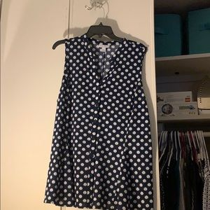 New sleeveless blue shirt with white dots.